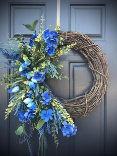 Blue Spring Wreaths, Spring Door Wreaths, Blue Wreaths, Door Decor, Blue Door Wreath, Gift for Her, Housewarming, Blue Decor, Fun Wreath How gorgeous is this blue color? Built on an 18 inch base (measures 23 x 30 in) this wreath is filled with blue flowers, a splash of yellow,