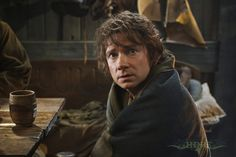 """Bilbo in Lake-town. """"For three days he sneezed and coughed, and he could not go out, and even after that his speeches at banquets were limited to 'Thag you very buch.'"""" LOOK AT THAT FACE. Martin, you are perfect."""