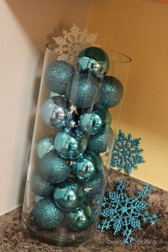 DIY Christmas Decor - Glass hurricane and your favorite colored Christmas ornaments.  Makes a great center piece or coffee table decoration.