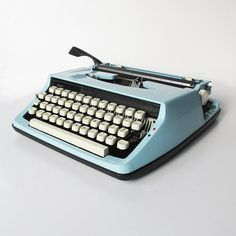 """1970s Brother - Sears Manual Portable Typewriter """"Light Blue & Black"""" with Original Owners Manual by leapinglemming on Etsy"""