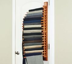 If you're like me and live out of your hamper with an empty clothing dresser sitting right next to it, this may come in handy to you. The trouser rack is a device that you can hang on your wall or doo...