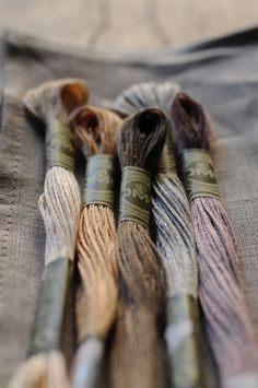 I love things made with hand embroidery. This makes them unique; in each is a human touch (embroidery threads of lovely, natural hues shown here)