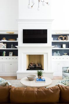 White+brick+fireplace+with+built-ins+||+Studio+McGee.jpg. Similar layout but no tv over fireplace. Bangor