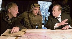 http://thinkingofrob.com/2015/08/11/new-bts-picture-of-robert-pattinson-and-werner-herzog-on-the-set-of-queen-of-the-desert/