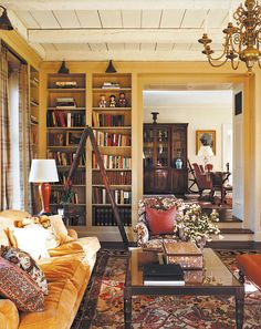 Beautiful red and yellow...the rug makes everything pop, books everywhere, and a view into the next room (Michael S Smith)