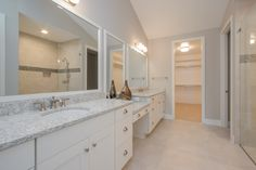 Owners Suite: Ceramic tile floors, double vanity, granite counter tops, walk-in closet, zero clearance shower, private water closet