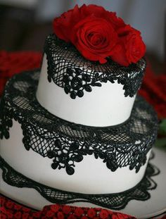 Elegant yet simple..again I would like to dress the cake with a Skellington or Corpse Bride topper.