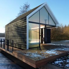 Island house | Rotterdam studio 2by4-architects designed this gabled summer house so the walls of one corner fold open. #architecture