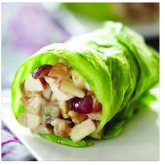 AWARD WINNING SALAD WRAPS -    Chicken Apple Wraps    Ingredients  1/2 cup chopped cooked chicken breast  3 tablespoons chopped Fuji apple  2 tablespoons chopped black or red grapes  2 tablespoons Crunchy Peanut Butter  1 tablespoon lite mayonnaise (or greek yogurt)  2 teaspoons honey  Iceberg lettuce    Preparation  Chop chicken meat and fruit, mix in bowl. Mix in peanut butter, mayonnaise and honey.    Spoon into open lettuce leaf, roll and serve
