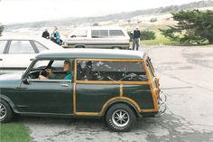 Rare photo of Clint Eastwood in his Mini Traveler Estate at the Pebble Beach Golf Classic, Carmel California in the 70's.
