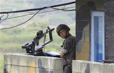 A South Korean soldier stands guard at a military checkpoint near the border village of Panmunjom, which has separated the two Koreas since the Korean War, in Paju, South Korea, Saturday, June 7, 2014. (AP Photo/Ahn Young-joon) ▼7Jun2014AP|North Korea says it is holding an American tourist http://bigstory.ap.org/article/north-korea-says-it-holding-american-tourist-0 #Paju #South_Korean_soldier #Panmunjom