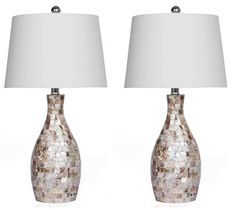 Add a touch of elegance to your space with this Devon and Claire favorite. This set of two table lamps each feature Mother of Pearl tiles along the resin base, coupled with a beige cotton shade. Size: W x H. White Table Lamp, Table Lamp Sets, Tripod Table Lamp, Desk Lamp, Living Room End Tables, Live Set, Unique Lamps, Drum Shade, Pearls