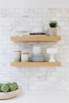 Kitchen with White Oak Floating Shelves against marble backsplash tile and white quartz countertop. Studio McGee