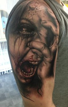 Horrific lifelike bloody face tattoo  Artist: Florina Karg