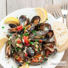 Mussels in Lemon Butter Wine Sauce is the perfect appetizer to share! It's succulent, tender, savory, and absolutely delectable!