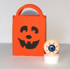 I used Plantin Schoolbook and Pumpkin Carvings to make the treat bag.      And it holds quit a bit of candy.      The lighted eyeball is a p...