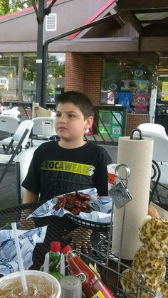 My oldest....andrew 9 years old....eating @ central bbq!!
