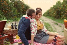 cute engagment with bushel of oranges
