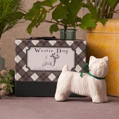 "Westie Dog Shaped Soap in Gift Box #DIVIDER# A great gift for the dog lover. The little white Westie dog soap is scented with a mix of Vanilla and Melon. Triple-milled, 100% vegetable based and ready to present in an adorable plaid gift box. Made in the USA Not tested on animals phthalate free SLS free paraben free Size, Quantity and Packaging Westie Dog Shaped Soap in Gift Box One (1) 4.5 oz Westie dog soap (4 3/4"" x 4"" x 3 7/8"") Gift Box #DIVIDER# Sodium Palmate, So..."