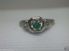 ANTIQUE ART DECO EMERALD & DIAMOND FILIGREE ENGAGEMENT RING RE-373  CIRCA ~ 1920'S  EMERALD ~ .20CT  MEDIUM GREEN COLOR  COUNTRY OF ORIGIN ~ COLOMBIA  2 SINGLE CUT DIAMONDS ~ .12CT  COLOR ~ E - F  CLARITY ~ VS 1 - VS 2  METAL ~ 18KW SOLID GOLD  WEIGHT ~ 2.8 GRAMS  MANUFACTURER ~ WHITE ROSE  NUMBERED ~ 9394  FINGER SIZE ~ 6 (SIZABLE) U.S.A. & CANADA   (L1/2) UNITED KINGDOM. IRELAND, AUSTRALIA & NEW ZEALAND