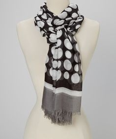 Layer on the luxury with this light and lovely scarf. Its posh pattern adds elegance to any look, while its featherlight construction is ideal for warming necks without weighing them down.
