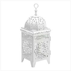 White Filigree Candle Lantern from KoehlerHomeDecor.com.  Bright white filigree pattern creates beautiful points of light in every direction!  Buy wholesale at Koehler Home Décor.
