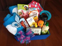 """Summer time is near, everyone could use a """"pool"""" basket of goodies. Cooler, towels, towel clips, lotion, sun screen, tanning oil, OPI nail polish, cup, and snack."""