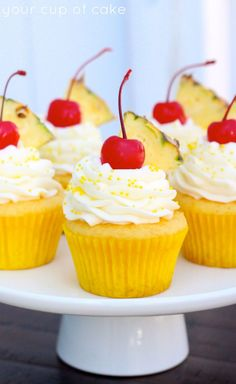 It's my favorite drink in cupcake form! Pineapple Cream Cupcakes will be my official dessert this summer! Pina Colada Cupcakes, Pineapple Cupcakes, Hawaii Cupcakes, Tropical Cupcakes, Cupcake Recipes, Baking Recipes, Dessert Recipes, Cupcake Ideas, Cupcake Flavors