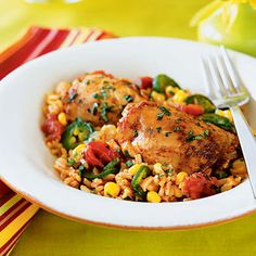 Chicken with Rice (Arroz con Pollo) -  We jazzed up this stand-by with lots of garlic, chiles, onions, corn, and tomatoes for an extra flavor punch.