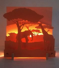 Light scene in three dimensions, shades of orange: savannah Play of an African savannah landscape Laser Cutter Ideas, Laser Cutter Projects, Orange Color Shades, Laser Art, Paper Design, Shadow Box, Paper Cutting, Savannah Chat, Wood Art