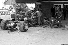 Far away from today's high-tech pit garages, Gold Leaf Team Lotus mechanics had to cope with an engine failure on Graham Hill's Lotus 49B at the 1969 British Grand Prix at Silverstone. The job took less than three hours with tools scattered over the paddock.