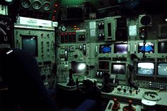 A bewildering collection of screens, wires, cables, switches, dials and levers make up the control console: