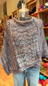 """Free Knitting Pattern for Denizen Poncho - Lynne Vogel's Denizen is an asymmetrical poncho with a lace panel flanked by sideways knitted stockinette panels and finished with crochet. She provides instructions for """"crocheting"""" with knitting needles. Poncho Knitting Patterns, Loom Knitting, Knitting Stitches, Knitting Needles, Knit Patterns, Free Knitting, Modern Patterns, Knitting Ideas, Free Knit Poncho Pattern"""