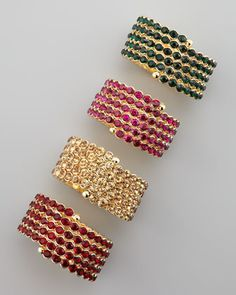 Crystal Spiral Bracelets (golden) by Cara Accessories at Neiman Marcus.