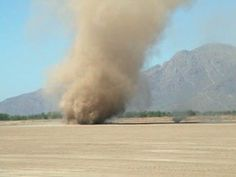 Arizona dust devil.  A Dust Devil is a rapidly rotating column of air carrying dust, leaves and other light-weight material; dust devils usually develop during hot, sunny days over dry and dusty or sandy areas