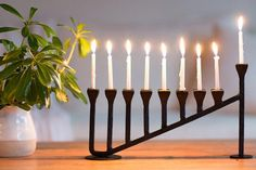 Handcrafted from solid iron using traditional blacksmith processes and stained in a black finish. Hanukkah Candles, Hanukkah Menorah, Hannukah, Wall Candle Holders, Candle Stand, Blacksmith Projects, General Crafts, Handmade Candles, Woodworking Projects Plans
