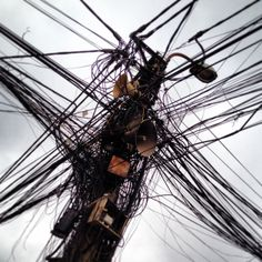 Stay connected, always (Hanoi, Vietnam) photo by: E.R.P. Elschott (Avenue '86 - creative design workshop) #stayconnected #connected #wires #cables #electricity #hanoi #city #chaos #vietnam