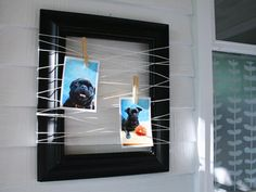 I might just have to do this. You can change the pictures whenever you want and it's a nicer way to feature photos then just slapping them up on the fridge with a magnet. Could be used for displaying cards too. Yep... just might have to...