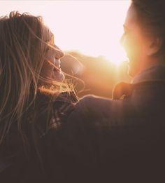 couple smiling at sunrise