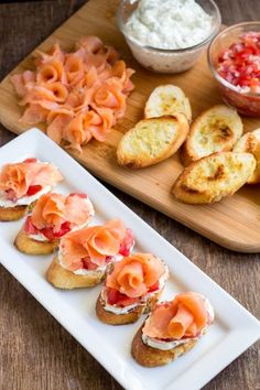 Quick and impressive appetizer in less than 30 minutes! Toasted baguettes topped with creamy herby filling and fresh tomato relish and smoked salmon! Delish!