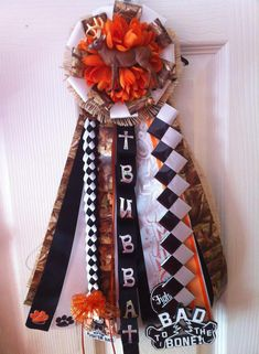 Camo Garder/ Mum for Homecoming Camo and orange ribbon with a burlap backing.