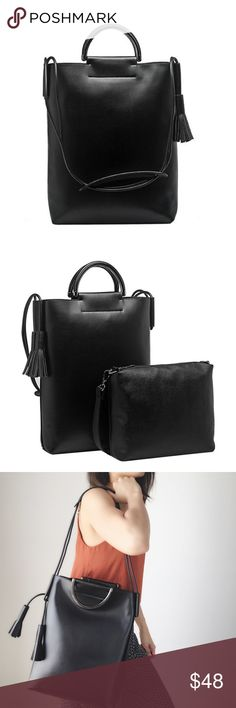 """Alaia large top handle bag. When I saw this I just have to carry it for the boutique. Very modern chic bag. Executive and casual chic look at the same time. Premium vegan . Leather top zipper . Slim interior pocket. longer strap included. ADDITIONAL pouch included. Tassels. 11""""L x 3.5W x 13.5H. Handle drop 3"""". Melie Bianco Bags Totes"""