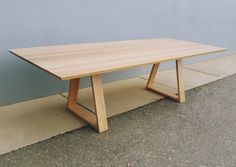 Axil style dining table made from American Oak timber.