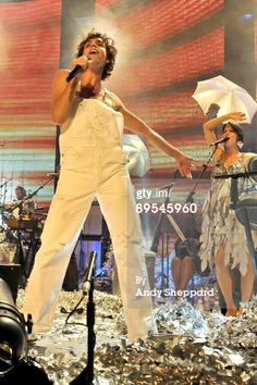 Mika performs at iTunes Live 2009 at The Roundhouse on July 31, 2009 in London, England (with Ida in the background)