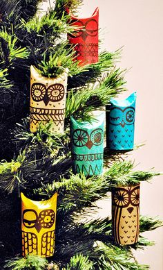 TOILET~PAPER ROLLS: up'd to Christmas Tree ornaments. Are these cute or what? They're actually just cardboard toilet paper rolls, painted in bright colors and decorated with black permanent markers. One end of the roll is simply pinched to create the owl's 'ears' – a fun and easy project for both kids and adults. FORGET GOING TO A BIG BOX STORE and piling a cart high with cheap, mass-produced holiday decorations made in China. Help the Earth and create lasting memories with the kids.