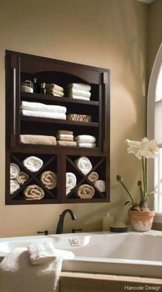 Built-in for towels maybe taller with drawers or doors below.