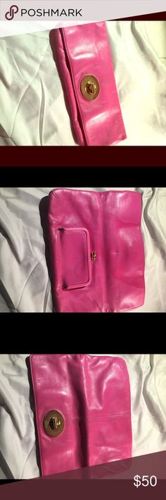Pink COACH Clutch So cute. I loved this clutch. It looks great, the inside is a little dirty because I loved it and used it but it could easily be cleaned out. It's a gem! Coach Bags Clutches & Wristlets