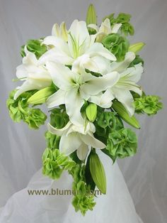 Gorgeous simple bouquet of soft white Lillys, bells of Ireland, which is a beautiful in season green flower with a loooong stem to add height or length to arrangements.