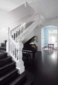 Dramatic white railings with black stairs