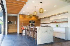 Kitchen with calcutta gold marble - Decoist
